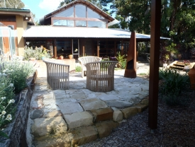 hand crafted sandstone edging and cobblestone paving to create a backyard sanctuary