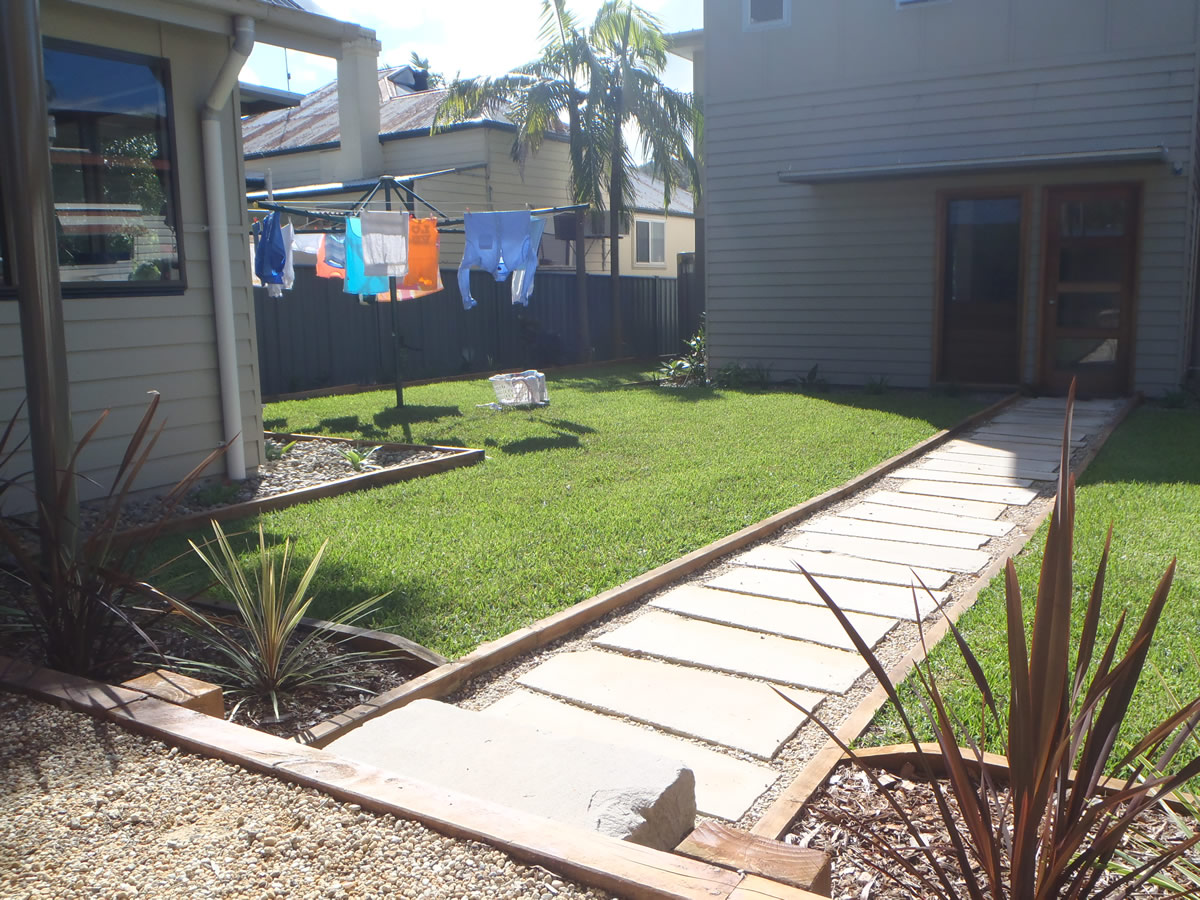 sandstone slabs, timber edging and buffalo lawn